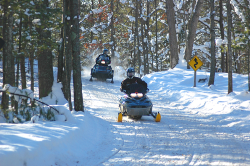 Snowmobiling the Boardman Valley Trail near Muncie Lakes