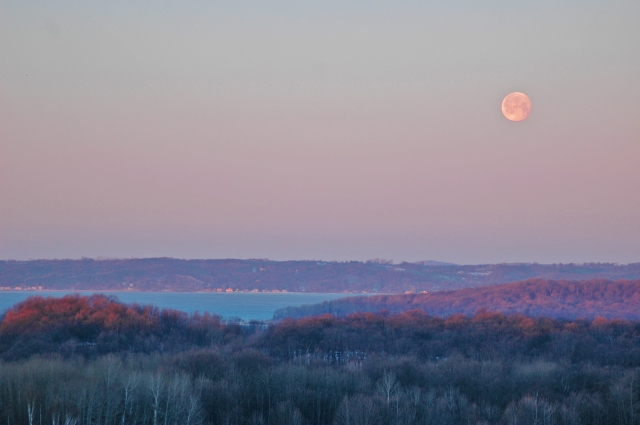Winter morning moonrise over West Bay, from Chateau Grand Traverse