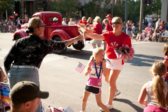 Handing out flags at last year's Cherry Festival Parade